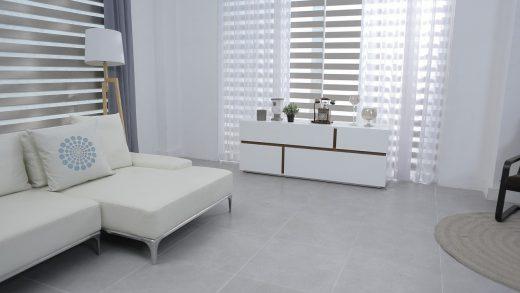 Astuces pour installer un rideau sans percer les murs de votre logement en location